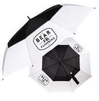 two opened black and white umbrella on white background with bear plumbing brand text for advertising